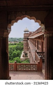 View of one of the towers of Agra Fort from an archway