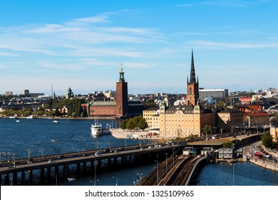 View onto Gamla Stan, Riddarholmskyrkan and Stockholm Stadshus with waterfront as seen from Södermalm during a hot summer day (Stockholm, Sweden, Europe)
