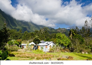 A view onto a solar powered cabin the interior of Reunion Island in the Cirque de Mafate