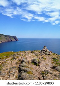 The view of the open and calm atlantic ocean along the sugarloaf trail in Newfoundland and Labrador, Canada