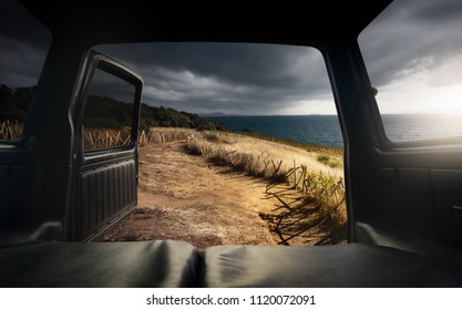 View from the open car trunk by top of mountain and sea.