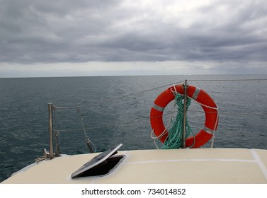 View of the open ocean from the deck of a yacht on a blustery day in landscape format with copy space