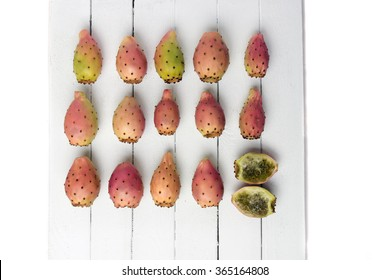 View of a Opuntia ficus-indica cactus fruits on a white wooden background.