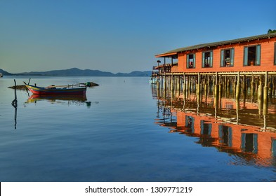 view of orange homestay and boat in the sea , Koh Pitak , Chumphon , Thailand