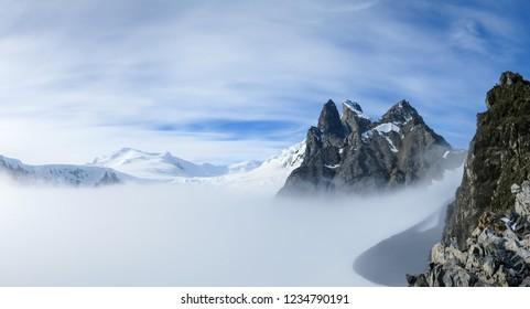 View of Orne Harbour glacier in mist from Spigot Peak, Antarctic Peninsula, Antarctica