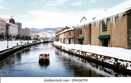 View of Otaru Canal in Winter season with signature tourist boat, Hokkaido - Japan.