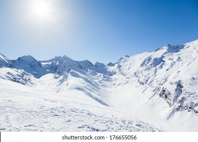 View of the Otztal Alps in Austria with a Bright Sun in the Clear Blue Sky