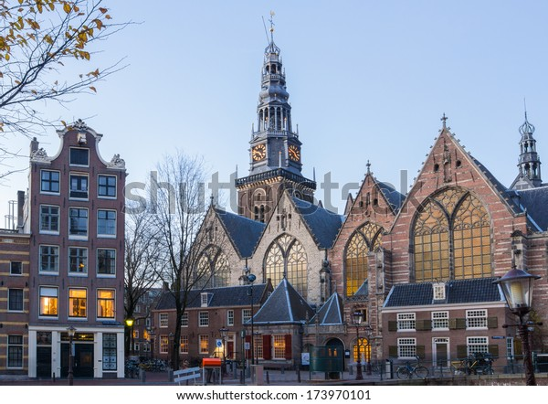 View of Oude Kerk (Old Church) from across the Oudezijds Voorburgwal canal in Amsterdam, Netherlands