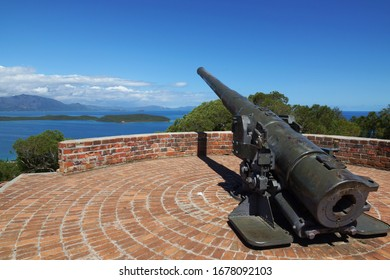 View from Ouen Toro Park on the blue sea water of Noumea harbour with the old canon on the foreground. New Caledonia.