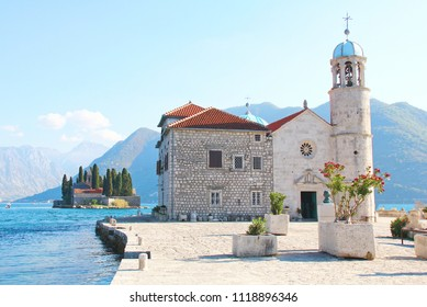 View of Our lady the rock island  church in persist Panoramic view at kotor bay of Montenegro,UNESCO world heritage site.in vintage color with grain.