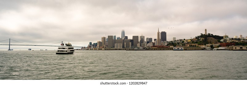 View from out in the bay of the long waterfront area along the San Francisco California downtown city skyline