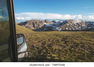 View out a camper van window of the Colorado mountains.