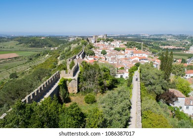 View out over the town walls that surround the medieval town of Obidos, Portugal