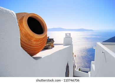 View out to sea over the white walls of Santorini, Greece