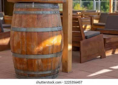 View of outdoor bar terrace, rustic wood, wooden barrels as decorative element, in Viseu city, Portugal