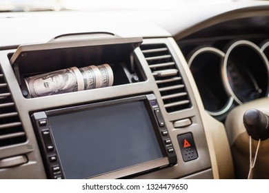 View from outside of the car at valuables wallet, Windows that are rolled down are open invitations for thieves to enter your vehicle