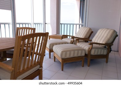 view of outside furniture on screened in lanai in florida