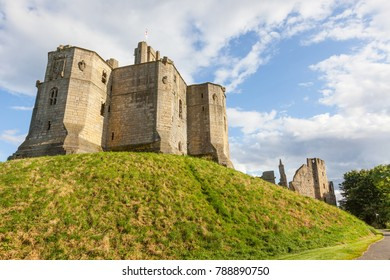 The view from outside the property of Warkworth Castle, a ruined medieval building in the village of the same name in the English county of Northumberland.