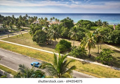 """A view of the outskirts of Havana from a rooftop. """"Megano"""" beach can be seen in the distance."""