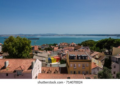View over Alfama area, modern colored house among old houses, Lisbon, Portugal