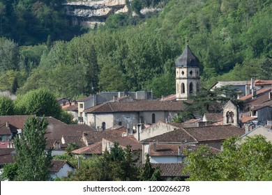 View over ancient rooftops in Ariege, France, with spire and forests in background