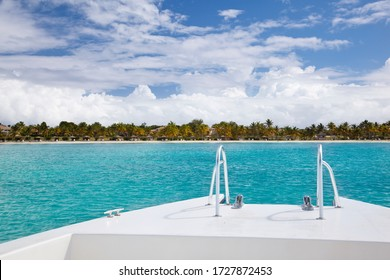 View over the bow of a boat to an exclusive island close to the Antiguan coast.