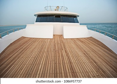 View over the bow of a large luxury motor yacht with bridge area on tropical open ocean