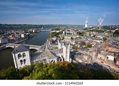 View over cathedral and city of Huy in Belgium at Meuse River to a distant nuclear power station.