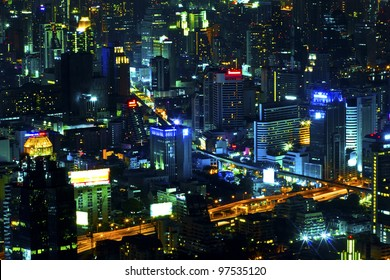 View over the city of bangkok at nighttime with skyscrapers