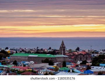View over city towards Santuario Maria Auxiliadora and Strait of Magellan at sunrise, Punta Arenas, Magallanes Province, Patagonia, Chile
