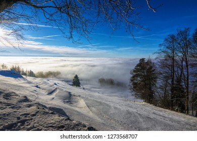 View over the clouds from the Zug mountain on a clear winter afternoon