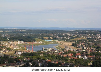 view over dortmund hoerde, where a lake is spreading on site of a former steelmill as a sign of structural change that has changed the ruhr region