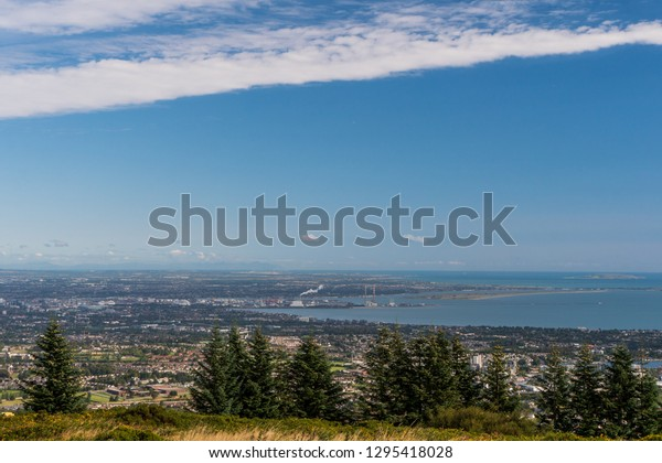 View over Dublin city, Ireland, from the Three Rock Peak, popular hiking path on a beautiful summer day for the Irish hillwalkers.