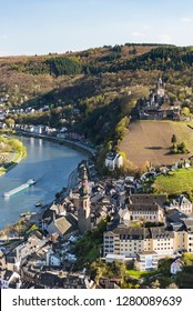 View over the famous city of Cochem in the Eifel with the Moselle River valley in Germany, and the Reichsburg Cochem in the background.