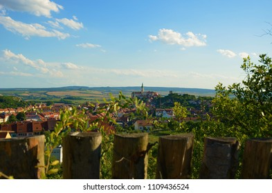 View over the fence near the historical city of Mikulov, Moravia, Czech Republic. In the background you can admire beautiful Mikulov Castle. Mikulov region is also famous for the wine production.