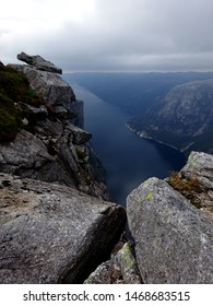 View over the Fjord with Steep Cliffs from Kjerag Boulder Hiking Trail near Lysebotn at Lysefjord, Rogaland, Norway, Scandinavia on a Cloudy and Overcast Day