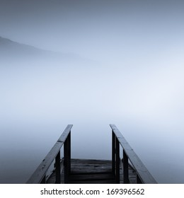 View over foggy seaside dock