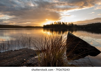 view over forest lake in sunrise in Sweden