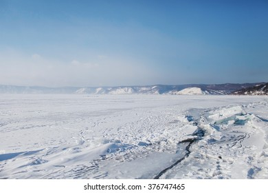 view over the frozen snow-covered mountains and Lake Baikal