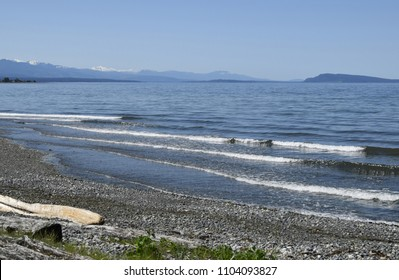 view over the Georgia Strait from Qualicum Beach on a suny day with blue sky, Vancouver Island  British Columbia Canada
