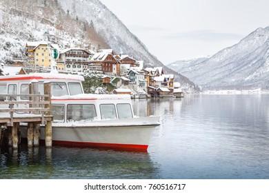 View over Hallstatt with boat in winter, Salzkammergut, Austria