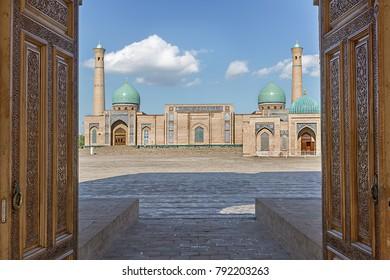 View over Hast Imam Mosque through wooden doors, Tashkent, Uzbekistan.