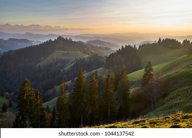 "View from the ""Lüderenalp"" over hilly Emmental landscape to the Bernese alps, county of Langnau, canton Bern, Switzerland"