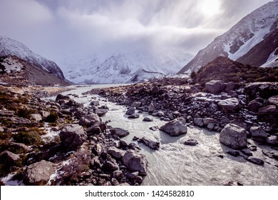 View over Hooker Valley in Aoraki national park New Zealand. There are snow mountain ranges, glacier, valley and rivers in this area. This is a famous and popular tourist attraction in the world.