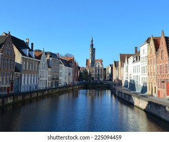 View over jan van eyck square taken from the channel in belgian bruges.