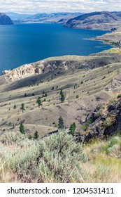 View over Kamloops Lake in July, looking towards Kamloops, Kamloops Hoodoos in sight, Thompson-Okanagan, British Columbia, Canada