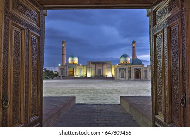 View over the Khast Imam Mosque through wooden doors, Tashkent, Uzbekistan.
