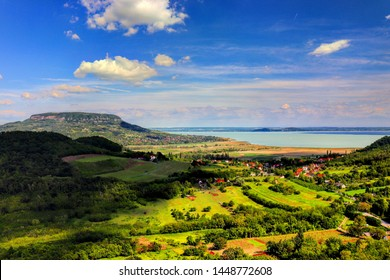 view over the lake of balaton, hungary, with the hill of badacsony in the background