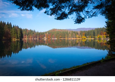 View over lake Laghi di Fusine to mountain range Mangart near Tarvisio in Italy on a sunny morning in autumn
