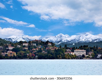 View over Lake Maggiore and Alps mountains with Verbania town in Northern Italy.